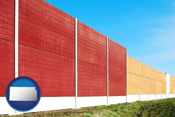 a highway noise barrier - with Kansas icon