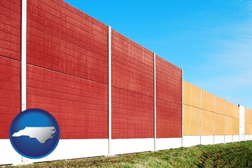a highway noise barrier - with North Carolina icon